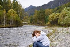 Mountain river. Portrait girl. Altai. Autumn landscape. Big green forest Royalty Free Stock Photography
