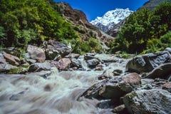 Mountain river and Rakaposhi stock photo