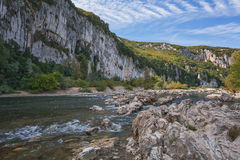 The mountain river with rapid current. Stock Photos