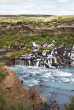 Mountain river with rapids and tourist man. Landscape of Iceland. The mountain river with rapids Royalty Free Stock Photos