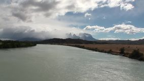 Mountain river and relax in Patagonia Argentina. Unique landscape of wildlife. Beautiful nature background. Travel and tourism in picturesque world of stone stock video footage