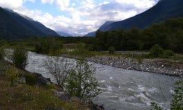 Mountain river. Reserve Teberda, Karachay-Cherkessia Republic, Russia. Photo taken on: July 27 Saturday, 2013 Royalty Free Stock Image