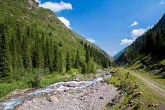 Mountain river and road in Kyrgyzstan Royalty Free Stock Photography