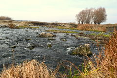 Mountain river. In the Siberian village. Autumn royalty free stock photography