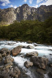 Mountain river skipping over the rocks Royalty Free Stock Images