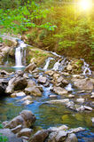 Mountain river with a small waterfall. The mountain river with a small waterfall royalty free stock image