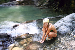 Mountain river and smile girl Stock Image