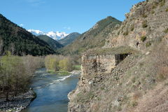 Mountain and river in Spain. Mountain (Sierra del Cadi) and river(Riu Segre) in Pyrenees,Catalonia,Spain Royalty Free Stock Photos