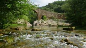 Mountain river with  stone bridge Stock Photography