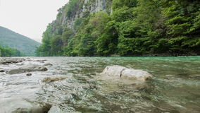 Mountain River And Stones. Fast mountain river with stones and rocks around stock video