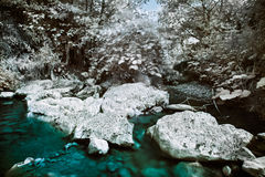 Mountain river with stones infrared photo Royalty Free Stock Photos