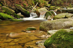 Mountain river stream with moss rocks. In autumn royalty free stock photo