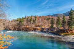 Mountain river sunny autumn day and cloudy sky Stock Photography