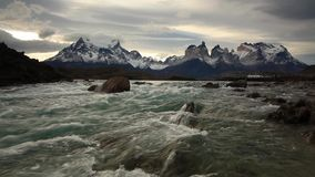 Mountain river at sunset with a view of the mountains. Torres del Paine, Chile stock video footage