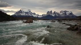 Mountain river at sunset with a view of the mountains. Torres del Paine, Chile stock video