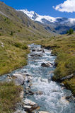 Mountain river in the swiss alps Stock Photos