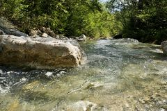 Mountain river in the Tyrolean Alps. In drinking water quality Stock Photos