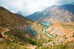 Mountain river under cloudy sky. Mountain moraine river under cloudy sky in summertime Royalty Free Stock Images