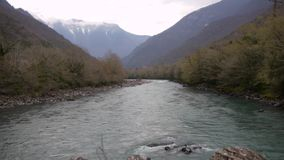 Mountain River in Valley stock video footage