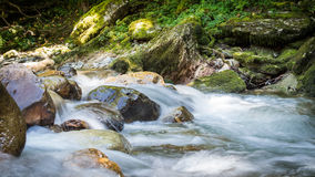 Mountain river. Water on rocks. stock photos