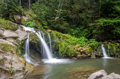 Mountain river with waterfall and rocks at national park in the Skole Beskids near Lviv Royalty Free Stock Photos