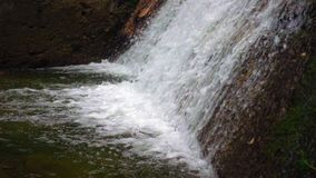 Mountain river waterfall in slow motion stock footage