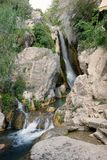 Mountain river with a waterfall among stones in Spain Stock Images