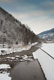 Mountain river in winter. Stream in the mountains in winter Royalty Free Stock Photo