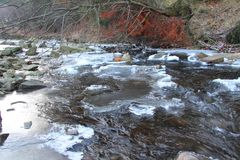 Mountain river in winter. With big pieces of ices Stock Images