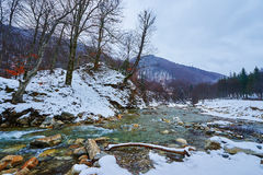 Mountain river on wintertime Royalty Free Stock Images