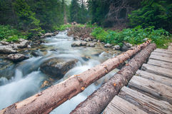 Mountain River and Wooden Bridge Royalty Free Stock Photography