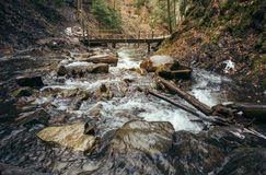 Mountain river and wooden bridge Stock Image