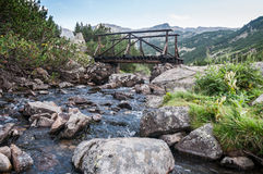 Mountain river and wooden bridge Royalty Free Stock Photo