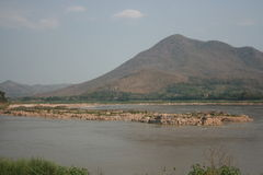 Mountain riverside. The great river view seen from Thailand side look at Loas mountain midle of river have rock. Relax, Vacation,Beach ,great river ,riverside Royalty Free Stock Images