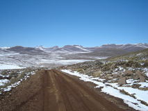 Mountain road. Dirt road going into the mountians Royalty Free Stock Photo