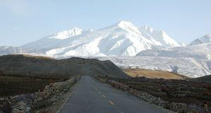 Mountain road. Cold mountain road in Tibet stock photo