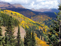Mountain Road. Highway winding though the striking Fall colors of the Colorado Rocky Mountains stock photos