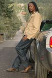 Mountain Road. A man leaning on his car on a mountain road Royalty Free Stock Images