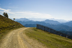 Mountain Road. Mountain trail with layers on mountains in the background with nobody in a sunny day - Austria 2007 Royalty Free Stock Image