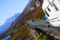 Mountain road. With car and caravan royalty free stock images