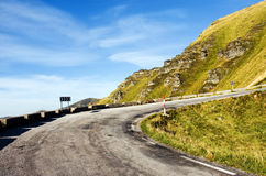 Mountain road. A mountain old road with cloudy skay Stock Images