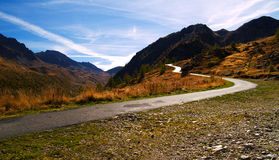 Mountain road. A mountain road with cloudy sky Stock Image