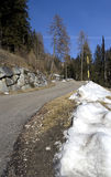 Mountain road. Little snowed secondary mountain road Royalty Free Stock Photography