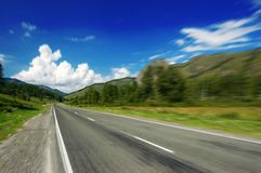 Mountain road. Speed on a empty mountain road Royalty Free Stock Photography
