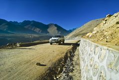 Mountain Road. A view of a jeep traveling on a mountain road in Tibet Stock Photography