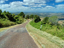 Mountain road. Country road down a mountainside Stock Images