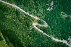 Mountain road aerial view. Asphalt zigzag in green forest Royalty Free Stock Photos
