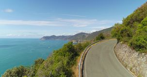 Mountain Road Aerial View. Amazing aerial view of beautiful Mediterranean landscape with curvy mountain road in the coastal seaside town. Top view of road to stock video