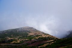 Mountain road against dense clouds. On Pico do Arieiro. Portuguese island of Madeira stock photos