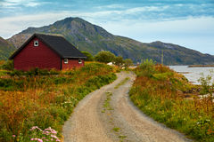Mountain road along fjord Stock Photo